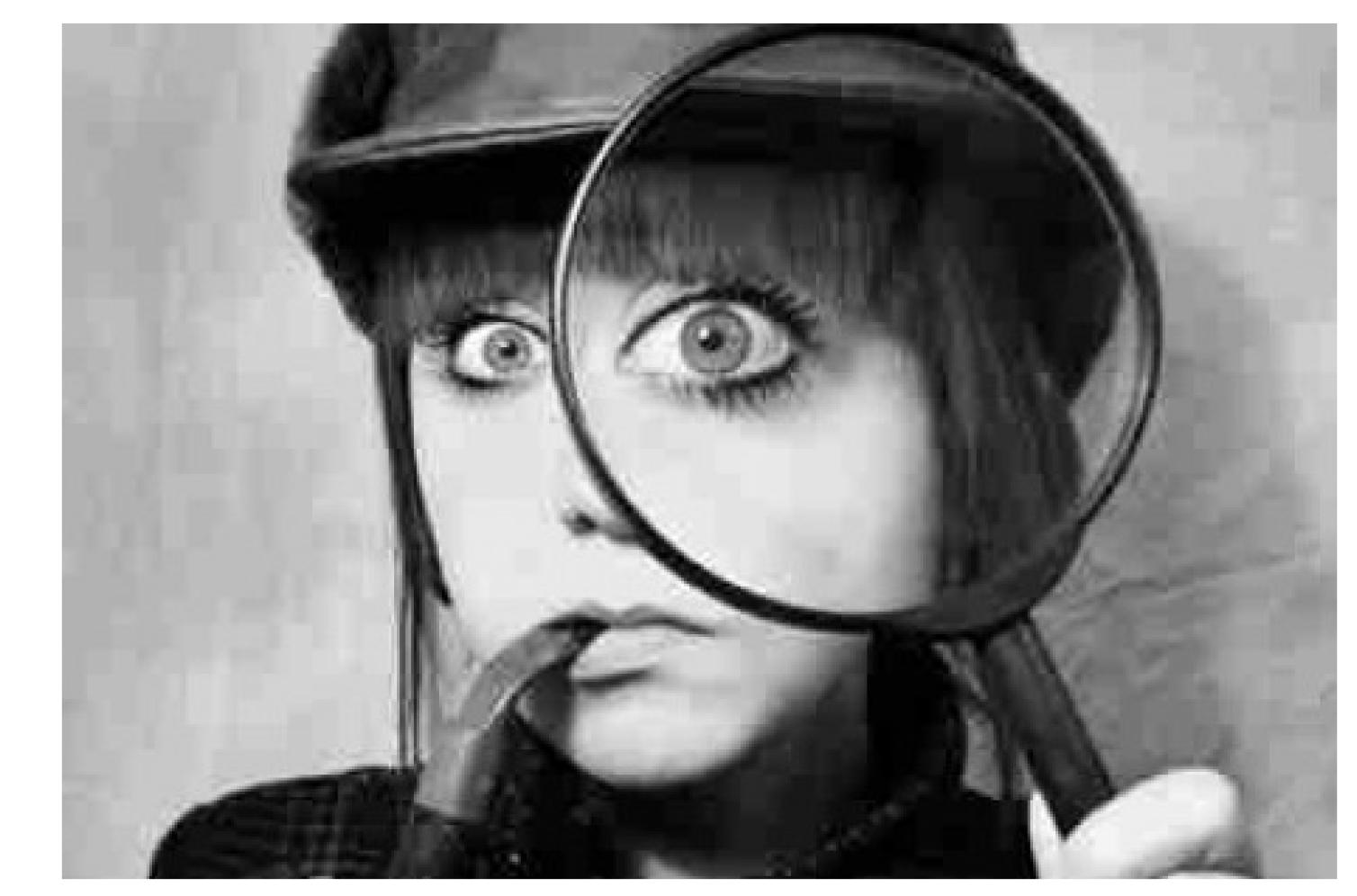 female detective with magnifying glass-left white